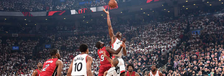 TORONTO, CANADA - MAY 15: Bismack Biyombo #8 of the Toronto Raptors goes for the tip off against Luol Deng #9 of the Miami Heat during the game in Game Seven of the Eastern Conference Semifinals during the 2016 NBA Playoffs on May 15, 2016 at the Air Canada Centre in Toronto, Ontario, Canada.  NOTE TO USER: User expressly acknowledges and agrees that, by downloading and or using this Photograph, user is consenting to the terms and conditions of the Getty Images License Agreement.  Mandatory Copyright Notice: Copyright 2016 NBAE (Photo by Ron Turenne/NBAE via Getty Images)