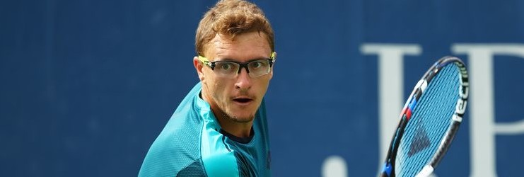 NEW YORK, NY - AUGUST 28: Denis Istomin of Uzbekistan returns a shot during his first round Men's Singles match against Albert Ramos Viñolas of Spain on Day One of the 2017 US Open at the USTA Billie Jean King National Tennis Center on August 28, 2017 in the Flushing neighborhood of the Queens borough of New York City.  (Photo by Clive Brunskill/Getty Images)