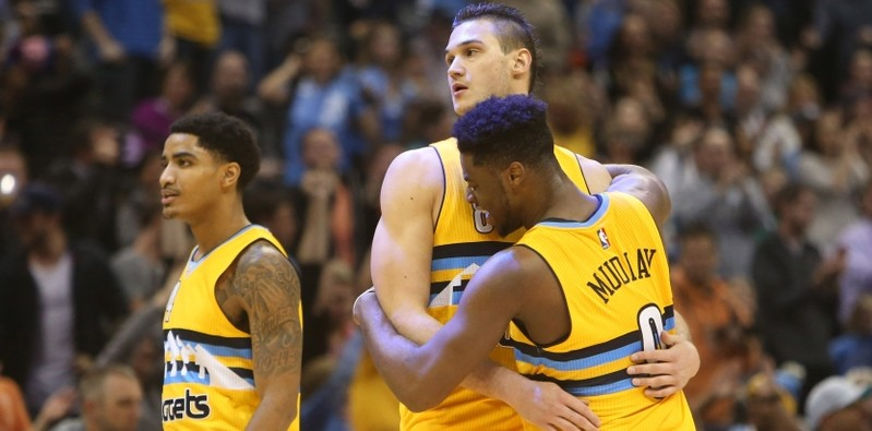 Jan 23, 2016; Denver, CO, USA; Denver Nuggets forward Danilo Gallinari (8) and guard Emmanuel Mudiay (0) celebrate during the second half against the Detroit Pistons at Pepsi Center. The Nuggets won 104-101.  Mandatory Credit: Chris Humphreys-USA TODAY Sports