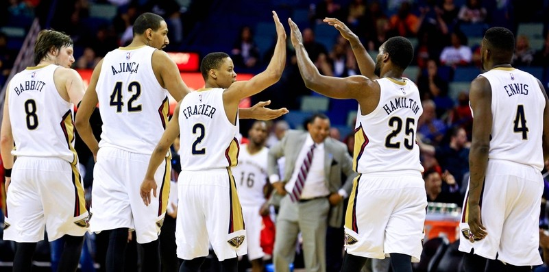 Mar 31, 2016; New Orleans, LA, USA; New Orleans Pelicans guard Tim Frazier (2) celebrates with forward Luke Babbitt (8), center Alexis Ajinca (42), guard Jordan Hamilton (25), and forward James Ennis (4) after scoring during the second half against the Denver Nuggets at the Smoothie King Center. The Pelicans won 101-95. Mandatory Credit: Derick E. Hingle-USA TODAY Sports