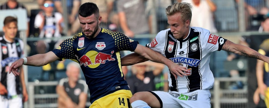 GRAZ,AUSTRIA,27.AUG.17 - SOCCER - tipico Bundesliga, SK Sturm Graz vs Red Bull Salzburg. Image shows Valon Berisha (RBS) and James Alexander Jeggo (Sturm). Photo: GEPA pictures/ Hans Oberlaender - For editorial use only. Image is free of charge.